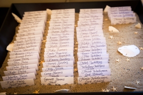 The place cards on a sea of sand, highlighted with sand dollars
